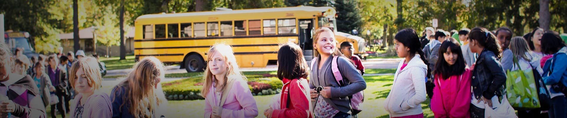 Photograph of students unboarding a school bus