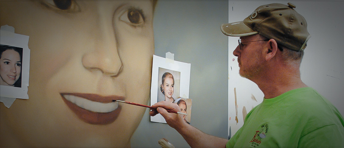 Scenic artist Blair Yeomans creates a portrait used in the 2010 production of <i>Evita</i>.