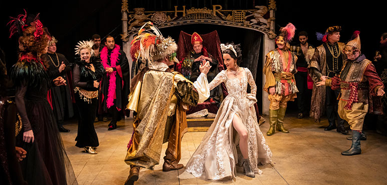 Jonathan Goad (centre) as King Henry VIII and Alexandra Lainfiesta as Anne Boleyn with members of the company in Henry VIII. Photography by Emily Cooper.