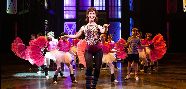 Blythe Wilson (centre) as Mrs. Wilkinson and Nolen Dubuc (far right) as Billy Elliot with members of the company in Billy Elliot the Musical. Photography by Cylla von Tiedemann.
