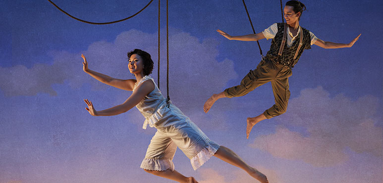image of two actors suspended by cables as if they were flying.